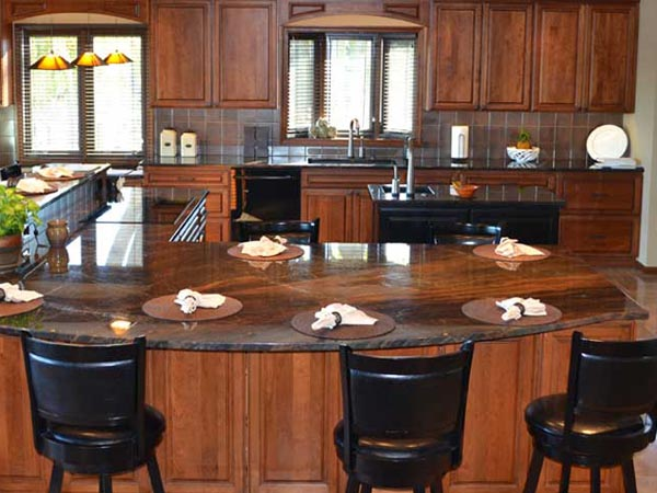 Modern, natural wood finish kitchen with elegant countertop featuring Starmark cabinets with design by Seiffert Kitchen & Bath